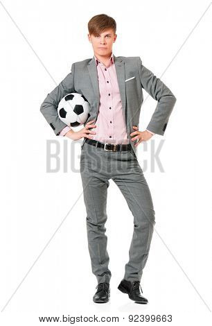 Young man in suit with soccer ball, isolated on white background
