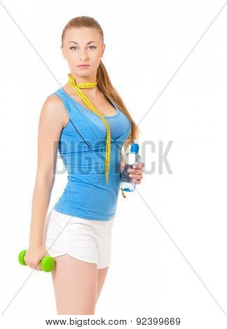 Young fitness woman with water, dumbbells and tape measure, isolated on white background