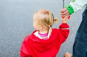 image of rainy day  - Toddler girl wearing red waterproof coat outdoor on rainy day - JPG
