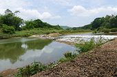 picture of collapse  - collapsing dam in the river in countryside of thailand - JPG