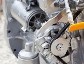 picture of lube  - Close up of transmission belt on car engine - JPG