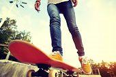foto of skateboard  - skateboarding legs riding on skateboard at skatepark - JPG