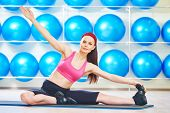 pic of do splits  - fitness woman instructor doing stretching pilates exercises split in sport club - JPG