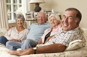 picture of retired  - Group Of Retired Friends Sitting On Sofa At Home Together - JPG