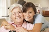 foto of visitation  - Teenage Granddaughter Visiting Grandmother At Home - JPG