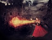 stock photo of witch ball  - beautiful woman witch trains in medieval castle cast magic  - JPG