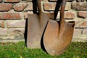 foto of shovel  - A spade and shovel are a rusty pair of hand digging implements - JPG