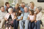 picture of grown up  - Large Family Group Sitting On Sofa Indoors - JPG