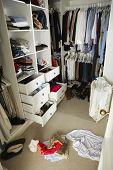 stock photo of untidiness  - Untidy Teenage Bedroom With Messy Wardrobe - JPG