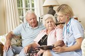 stock photo of retired  - Retired Senior Woman Having Health Check With Nurse At Home - JPG