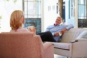 picture of hot couple  - Mature Couple At Home Relaxing In Lounge With Hot Drink - JPG