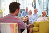 pic of extended family  - Extended Family Group At Home Relaxing In Lounge - JPG