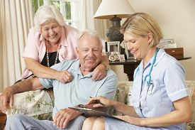 picture of retirement  - Retired Senior Man Having Health Check With Nurse At Home - JPG