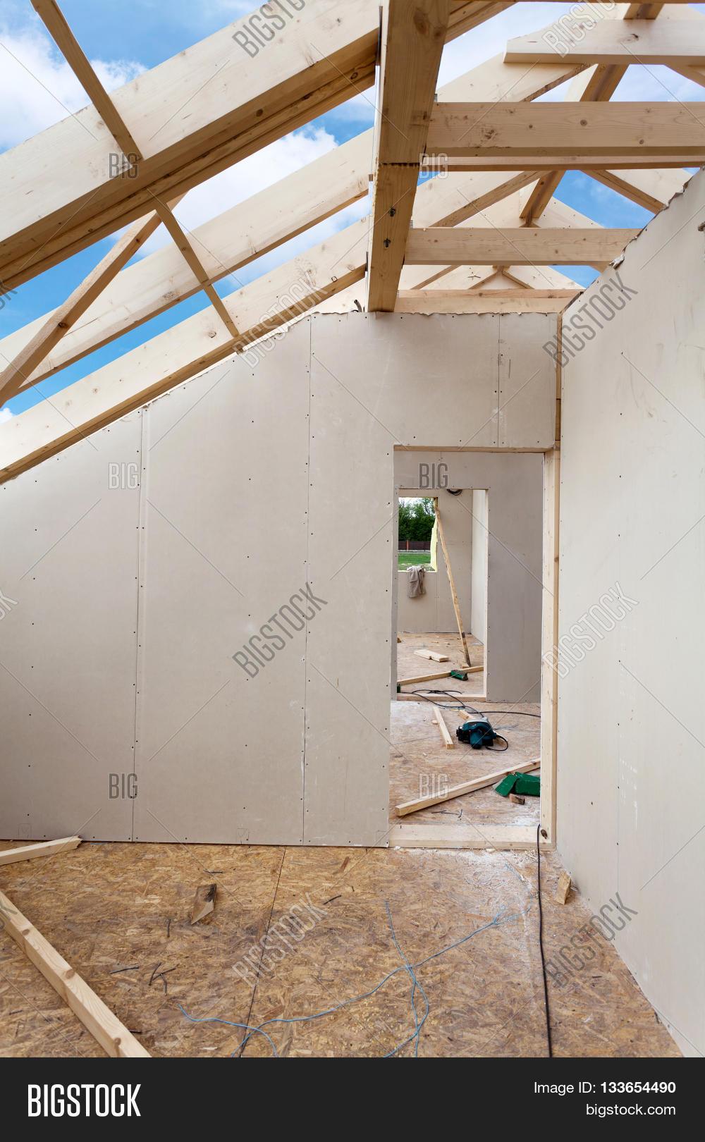 Attic Room Under Construction With Gypsum Plaster Boards