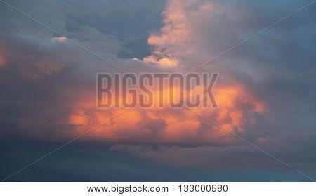 Cumulus clouds at sunset in a sky