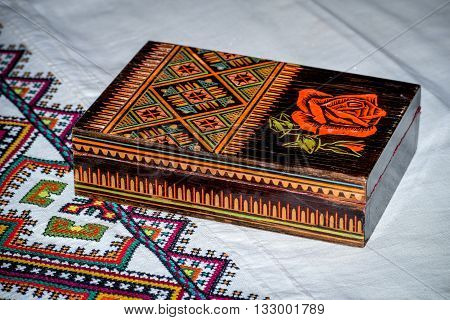 Wooden old casket in ukrainian folk style