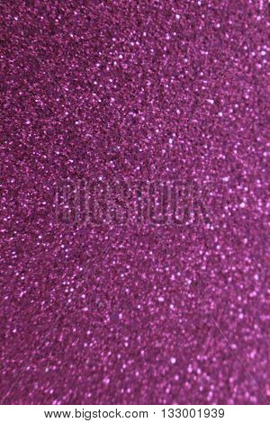 This is a abstract blur of violet glittery background