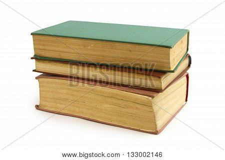 Three vintage old books on white background