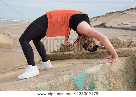 Teenage Young Girl Dancing Hip-hop And Jumping On Beach, Summer