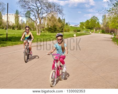Bikes cycling girl. Girl rides bicycle in park. Girl in cycling riding on bicycle lane . Cycling is good for health. Cyclist looking at camera.