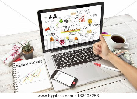 Business desktop and Strategy Concept on computer.