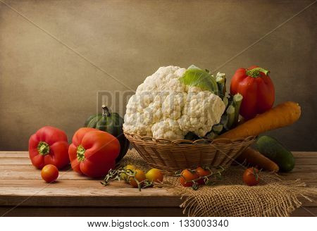 Still life with fresh vegetables on wooden table