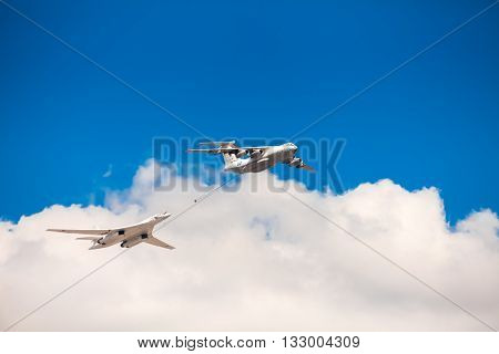 MOSCOW, RUSSIA - MAY 7, 2016: Avia parade in Moscow. The Ilyushin Il-78 is a Soviet four-engined aerial refuelling tanker and Tupolev Tu-160 White Swan is a supersonic, variable-sweep wing heavy strategic bomber on parade in Moscow, Russia