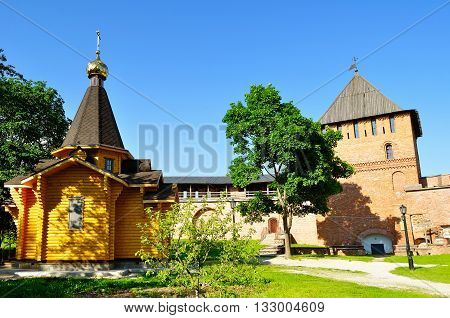 Chapel of St Vladimir - Prince of Novgorod and baptist of Rus and Vladimir Tower in Kremlin in Veliky Novgorod Russia. Spring architectural landscape