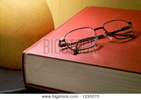 Book And Glasses Under Lamp