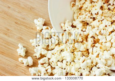 Homemade sweet corn popcorn on wooden table close up