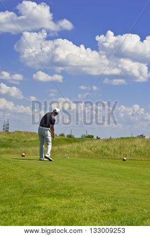 Man Playing Golf on  Golf Course. Hitting Golf Ball