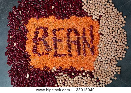 Group of beans lentils and chick-pea on black background. beans assortment. sign