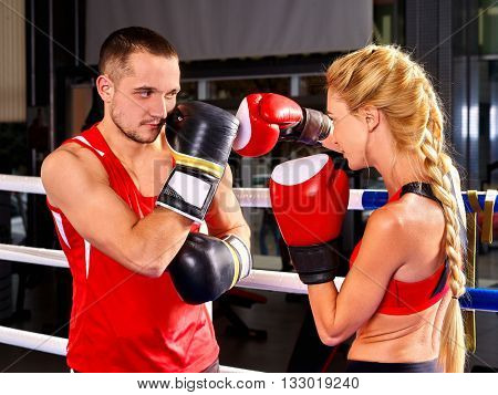 Couple Man and Woman Wearing Gloves Boxing in sport Ring. Martial art sport.