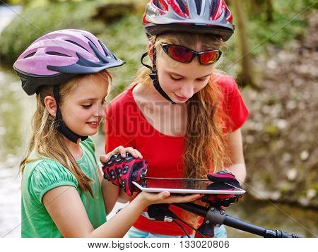 Bikes cycling girl. Girl rides bicycle. Girl in cycling near bicycle watch pc tablet. Cycling is good for health. Cyclist looking for road.