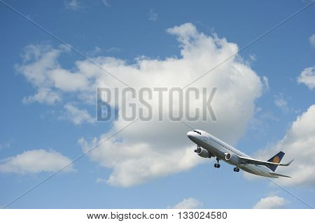 Plane takes off against the blue cloudy sky. Takeoff. Collage.