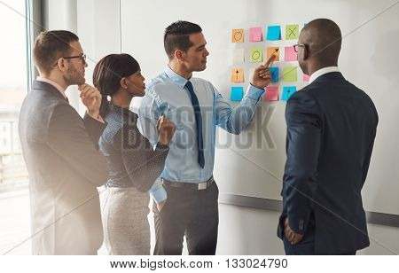 Multiracial Group Of Colleagues Discussing A Plan