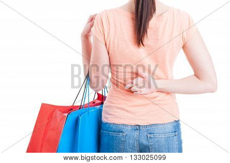 Woman Holding Shopping Bags Showing Fingers Crossed Behind Back