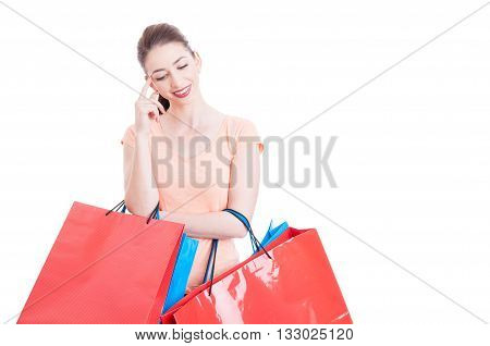 Young Lady Holding Shopping Bags Thinking And Smiling