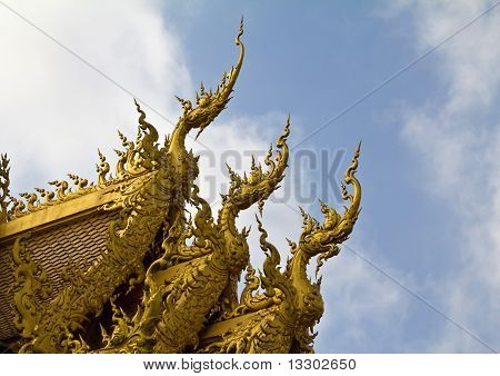 Golden Naga Sculptures at white temple