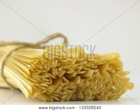 bunch of dry linguini on the white background