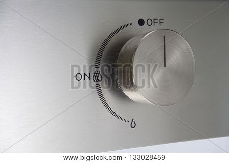 close up of the knob of gas stove