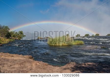 Rainbow Seen From Top Of Victoria Falls