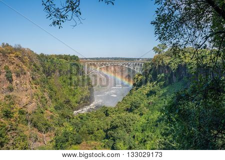 Rainbow Spanning Gorge Beneath Victoria Falls Bridge