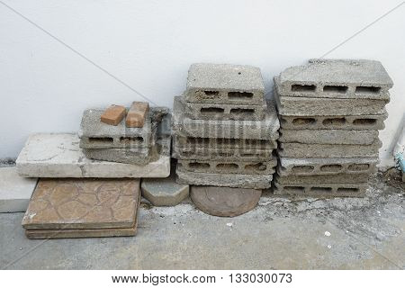 Keeping leftover building materials after construction. It can be used as a concept of waste; recycle or saving.