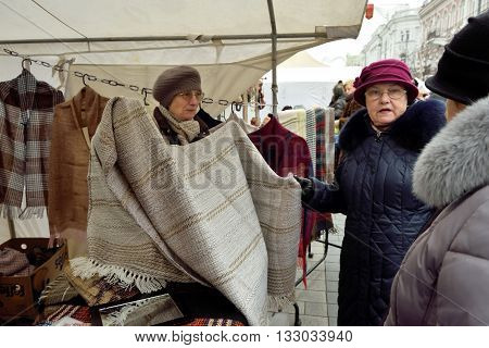 VILNIUS LITHUANIA - MARCH 4: Unidentified people trade traditional Linen Fabric in annual traditional crafts fair - Kaziuko fair on Mar 4 2016 in Vilnius Lithuania