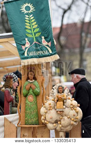 VILNIUS, LITHUANIA - MARCH 4: Unidentified people trades wooden dolls in annual traditional crafts fair - Kaziuko fair on March 4, 2016 in Vilnius, Lithuania