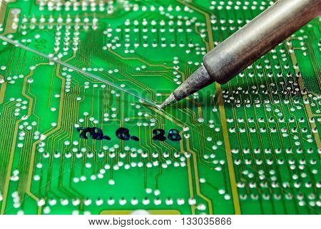 Soldering wire on the pcb. Electronic device reparing in servise