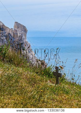 Wooden crosses on the edge of white chalk cliffs the place of suicides. Eastbourne, East Sussex, England