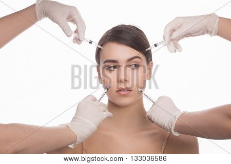 Cosmetic injection in the spa salon. Beautician makes injection into patient's face. Beauty injections, mesotherapy, revitalization, cosmetic medicine injection. Concept of rejuvenation.