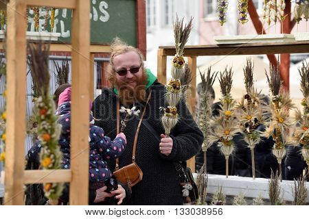 VILNIUS LITHUANIA - MARCH 6: Unidentified people trade traditional palm bouquets in annual traditional crafts fair - Kaziuko fair on March 6 2016 in Vilnius Lithuania